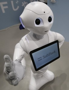 "SoftBank Corp's human-like robot named ""Pepper"" is displayed at its branch, in Tokyo, in this June 6, 2014 file photo. Nestle SA will enlist a thousand humanoid robots to help sell its coffee makers at electronics stores across Japan, becoming the first corporate customer for the chatty, bug-eyed androids unveiled in June by tech conglomerate SoftBank Corp. The waist-high robot was touted by Japan's SoftBank as capable of learning and expressing human emotions, and of serving as a companion or guide in a country that faces chronic labour shortages. Nestle said on October 29, 2014 it would initially commission 20 of the robots, called Pepper, in December to interact with customers and promote its coffee machines. By the end of next year, the maker of Nescafe coffee and KitKat chocolate bars plans to have the robots working at 1,000 stores. REUTERS/Yuya Shino/Files (JAPAN - Tags: SCIENCE TECHNOLOGY BUSINESS SOCIETY)"